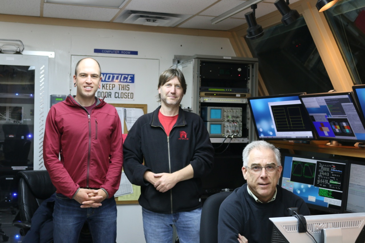 Todd Mackenzie, Doug Johnstone, and Gary Davis in the JCMT control room on the last night of Canadian observing under NRC management. (Photo Credit: T. McLaughlin)