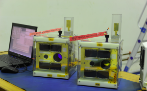"Figure 3 - The two Canadian BRITE nanosatellites (named ""BRITE-Montreal"", blue filter and ""BRITE-Toronto"", red filter), at UTIAS-SFL prior to shipment in 2014."
