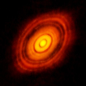 "The amazing image of HL Tau obtained by ALMA with 10+ km baselines. This image is at a wavelength of 1.3 mm and has an angular resolution of just 0.035"" (5 AU at the 150 pc distance of HL Tau). The size of this disk is about 3 times the size of our solar system. Credit: ALMA (ESO/NAOJ/NRAO)."