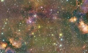 FSR 584 - Pouponnière d'étoiles ou vieil amas globulaire dans la plan galactique? Cette image prise avec la caméra infrarouge WIRCam au télescope Canada-France-Hawaï réfute l'hypothèse de l'amas globulaire car le nombre d'étoiles comprises dans FSR 584 est trop faible pour maintenir une cohésion gravitationnelle à long terme. (de/from Loïc Albert, U. de Montréal)