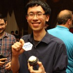Angus Mok with a TMT cupcake (Photo by Aaron Springford)
